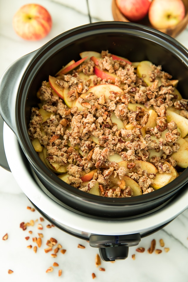 With a super crisp, nutty topping blanketing a warm and cozy, apple cinnamon-spiced filling, this Skinny Slow Cooker Apple Crisp is absolutely irresistible! Vegan, Paleo, Gluten-Free, Dairy-Free.