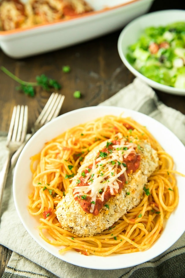 Quick and easy, this Gluten Free Chicken Parmesan is a classic Italian favorite made lighter in this recipe, by baking instead of frying. Don't worry, though, it's still as tasty, crispy and family-friendly as the original!