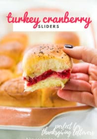 leftover turkey cranberry slider in woman's hand