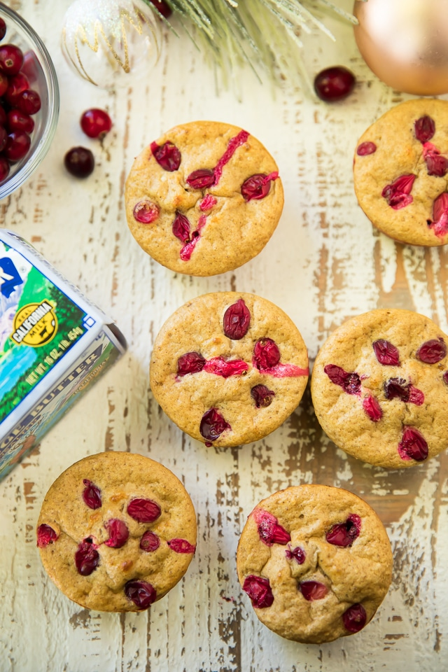 Cranberry Apple Muscle Muffins have a festive burst of flavor and plenty of protein to power your day of gifting!