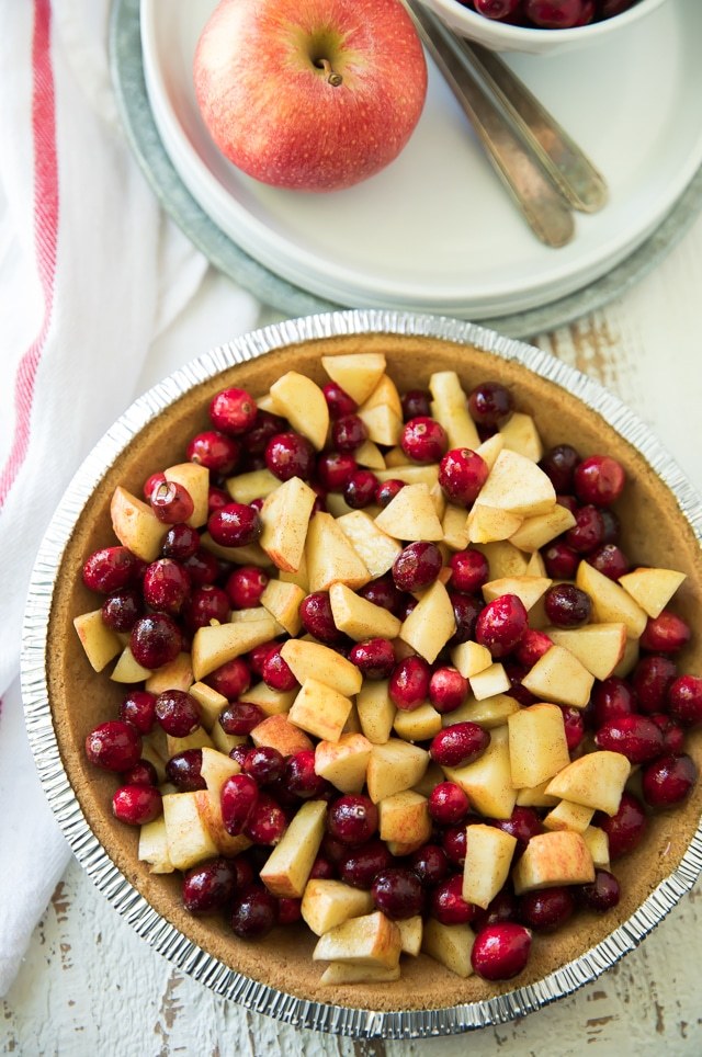 This Gluten Free Cranberry Apple Crumble Piehas all of the warmth, spice and sweet flavor of the holiday season. Also, it's ridiculously simple to throw together and will make the perfect addition to your festive dessert spread!