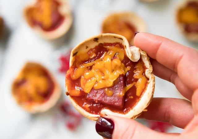 These crowd pleasing Mini Party Pizzas are cheesy and delicious! They're the perfect easy recipe for serving at your next party, game day or tailgate!