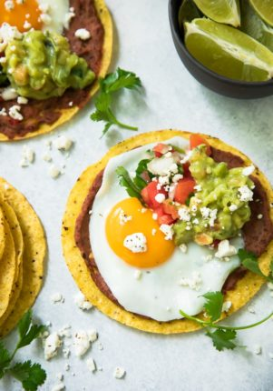These Black Bean Hummus Breakfast Tostadas will surely make all of your morning meal dreams come true! Bursting with fresh flavor and texture, this deliciousness will fuel you through the day!