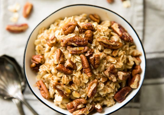 Easy Pecan Pie Protein Oatmeal is a nutritious morning meal packed with protein and loaded with pecan pie yumminess!