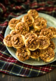 These Pecan Pie Tarts have been a family favorite for as long as I can remember. They're the BEST treat to enjoy and give during the holiday season. Perfectly sweet, with an ooey gooey center and flaky melt in your mouthbuttery crust. Your family and friends are sure to love this dessert!