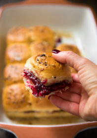 Turkey Cranberry Sliders are a quick and easy recipe to use up that leftover turkey and cranberry sauce from the holidays! Hawaiian rolls are loaded with turkey, cranberry sauce and your favorite cheese for a tasty lunch or dinner after the big meal.