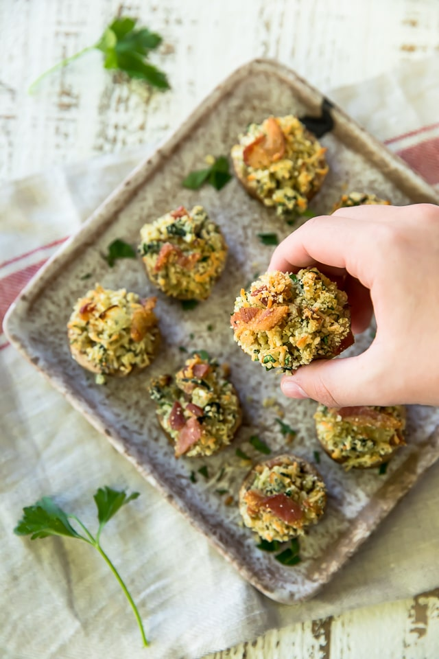 These Bacon Stuffed Mushrooms are the perfect app for your next party! Who doesn't love this cheesy and bacon filled deliciousness in the bite-sized perfection of mushroom caps?!