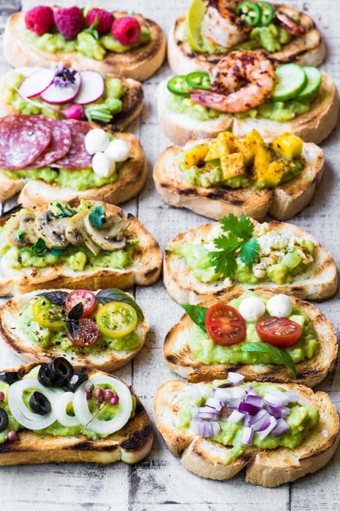 Guacamole Bruschetta Bar | The View From Great Island Avocado toast is great, but a guacamole bruschetta bar is even better! Set of a spread of toppings such as salami, roasted veggies, and fresh fruits so you and your guests can DIY all sorts of different varieties of bruschetta!