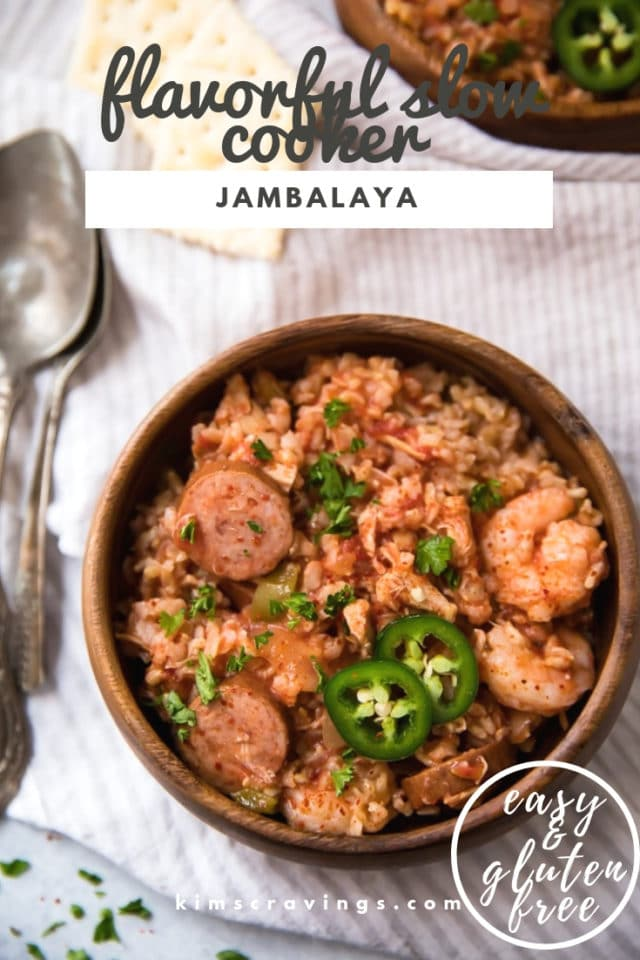 Slow Cooker Jambalaya served in a wooden bowl and topped with jalapeños