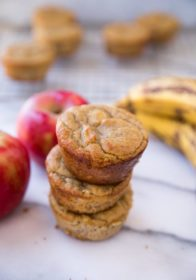 Flourless Banana Apple Muffins stacked up on a marble counter