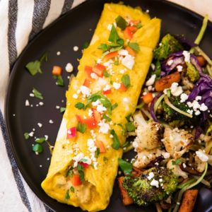 This Hummus Feta Omelet is super filling, low in carbs and packed with protein. Plus, it's delicious. Hummus is surprisingly so tasty with eggs!