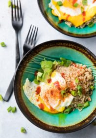 This hearty and filling Easy Fried Egg, Rice, Avocado Bowlwill warm you up, fill you up, and STILL help you fit into your skinny jeansbecause it's loaded with protein, fiber, and essential vitamins and minerals... now that's my kind of breakfast!