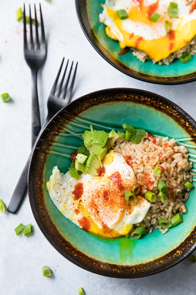 This hearty and filling Easy Fried Egg, Rice, Avocado Bowl will warm you up, fill you up, and STILL help you fit into your skinny jeans because it's loaded with protein, fiber, and essential vitamins and minerals... now that's my kind of breakfast!