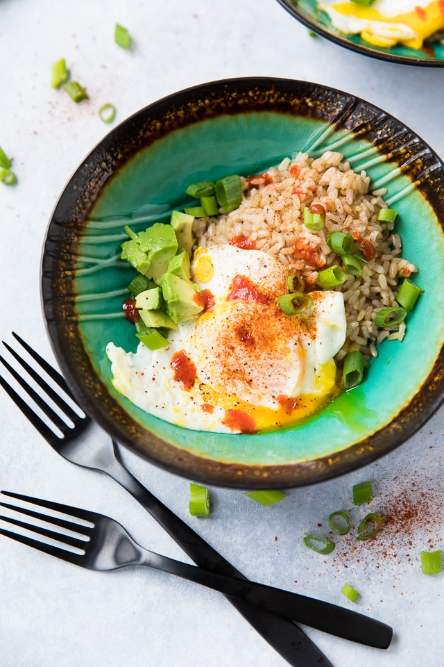 This hearty and filling Easy Fried Egg, Rice, Avocado Bowl will warm you up, fill you up, and STILL help you fit into your skinny jeans because it's loaded with protein, fiber, and essential vitamins and minerals!