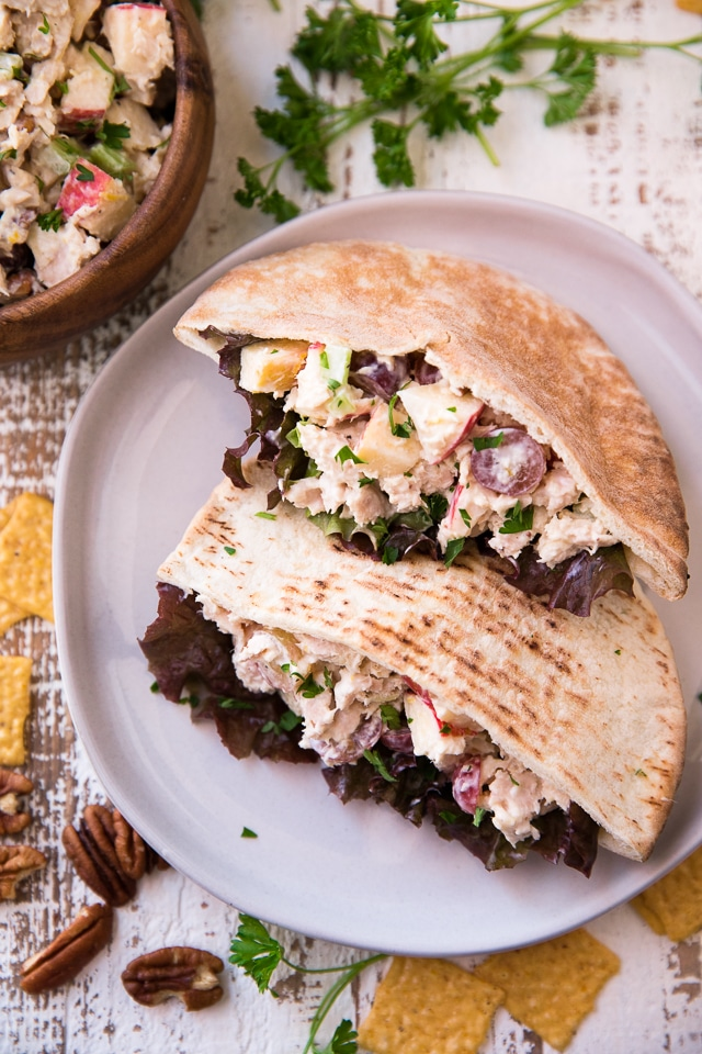 pitas stuffed with tuna salad served on a white plate