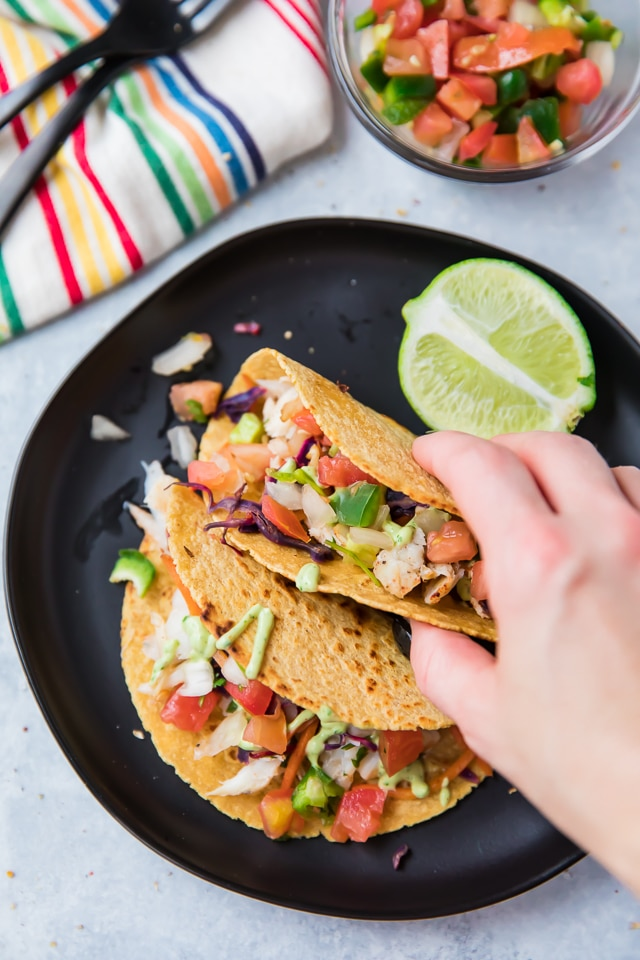 Alaska Cod Fish Tacos with a Creamy Avocado Dressing - quick, easy, delicious and even kid-friendly!