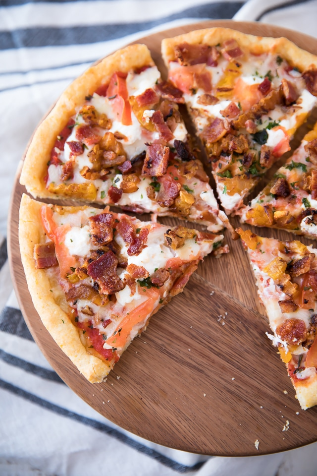 This Butternut Squash, Bacon, Goat Cheese Pizza comes complete with sweet butternut squash, bacon, three yummy cheeses (including my favorite - goat cheese) and the most phenomenal crispy cornmeal crust.