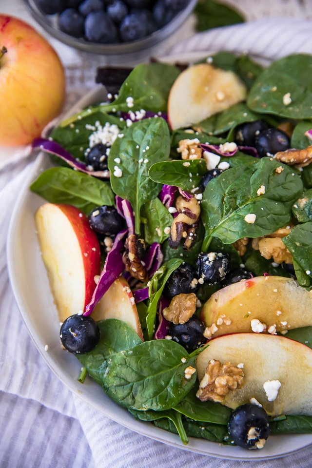 This Heart Healthy Blueberry Spinach Salad is a light and refreshing salad completely loaded with good stuff: sweet apple slices, blueberries, feta cheese, walnuts, fibrous heart healthy spinach and tossed in a flavorful balsamic vinegar.