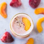 This Tickled Pink Strawberry Peach Protein Smoothie made with a combo of two of my favorite fruits is packed with protein, antioxidants, vitamin C, and potassium. It's also simple, fruity and refreshing! The perfect treat for breakfast, snack, or even dessert!