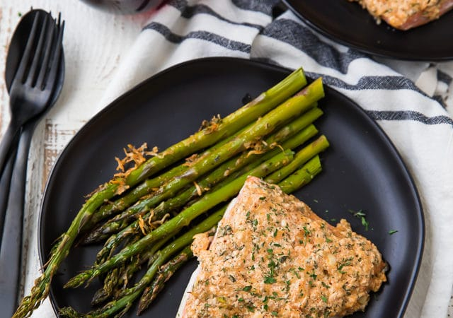 This Garlic Parmesan Salmon and Asparagus dish is a complete sheet pan supper with ONE PAN to clean! And is made extra delicious with an epic garlic parmesan crust! So easy and SUPER tasty!