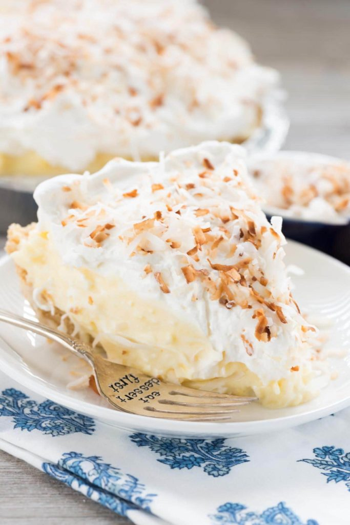 This pie recipe is full of coconut pudding, fresh whipped cream, and a Golden Oreo crust! This pie goes down so easy!