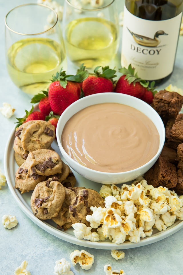 Creamy, silky and delicious, this Chocolate Peanut Butter Dip is an addicting addition to your appetizer or dessert spread!