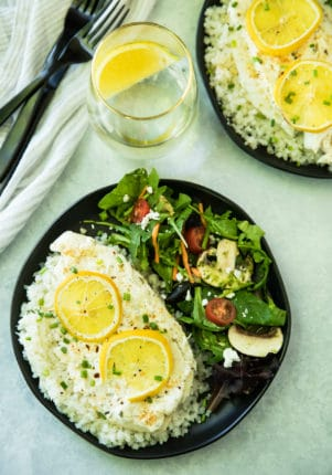 Garlic Parmesan Tilapia Over Cauliflower Rice is ready in less than 20 minutes! The tilapia cooks up light and flakey, and pairs wonderfully with cauliflower rice. It's one of my favorite ways to enjoy fish, and is so good, that even non-seafood lovers will be won over by this dish!