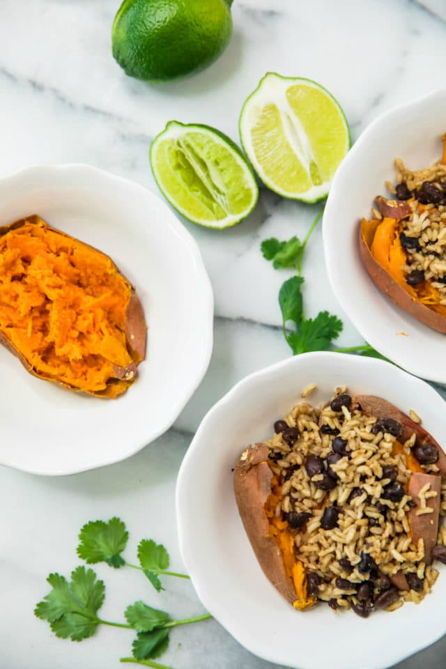 Healthy Sweet Potato Burrito Bowls stuffed with brown rice and beans in white bowls