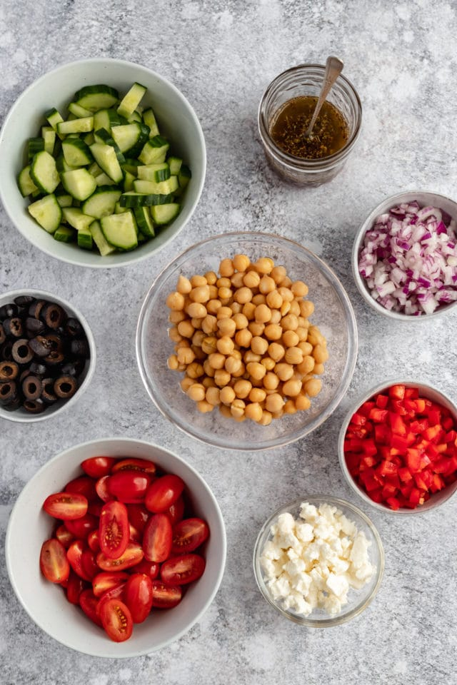 ingredients for chickpea salad in small bowls