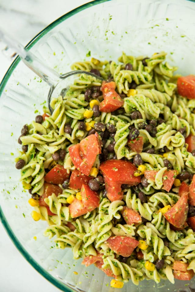 closeup view of Southwest Jalapeño Pesto Pasta Salad in a glass bowl