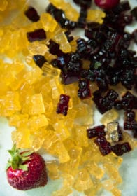 overhead view of yellow and dark red gummy bears
