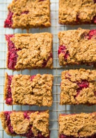 overhead view of Raspberry Almond Oat Bars on gold wire cooling rack