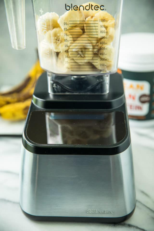 banana slices in a Blendtec blender for a SkinnyS'mores Protein Shake