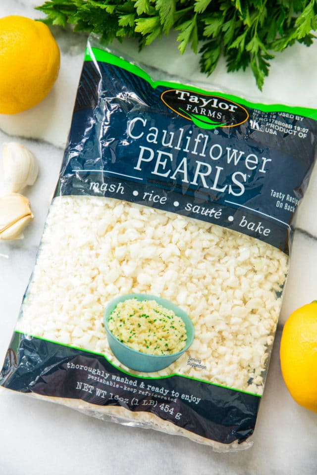 package of cauliflower pearls to be used for Simple Lemon Parsley Cauliflower Rice