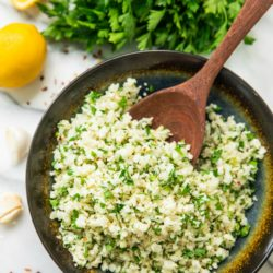 LOVE this easy to make Simple Lemon Parsley Cauliflower Rice!! Add some roasted salmon or grilled chicken on top and you have a wholesome, flavorful, and delicious gluten free meal!