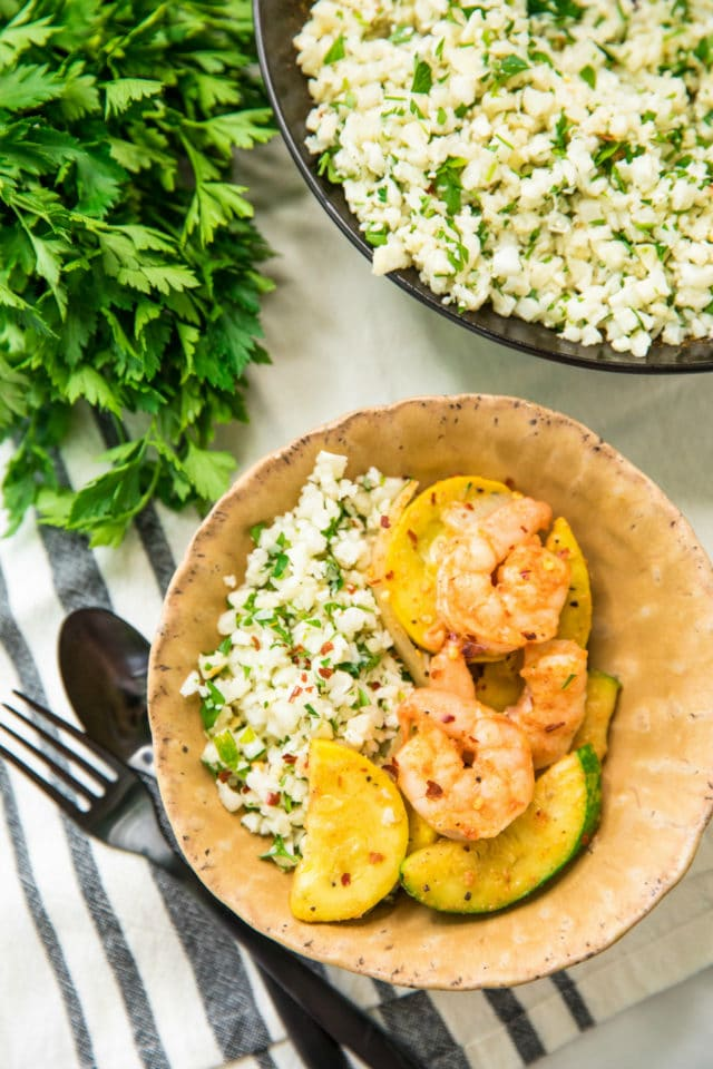Easy Shrimp Zucchini Squash Skillet served in a tan bowl over cauliflower rice