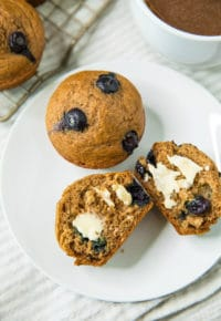Healthy Blueberry Banana Muffins on a white plate with butter