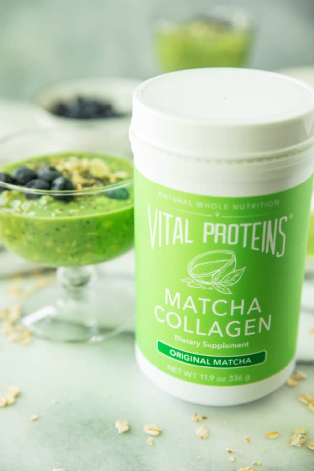 canister of Vital Proteins Matcha Collagen sitting next to a glass of Matcha Collagen Overnight Oats
