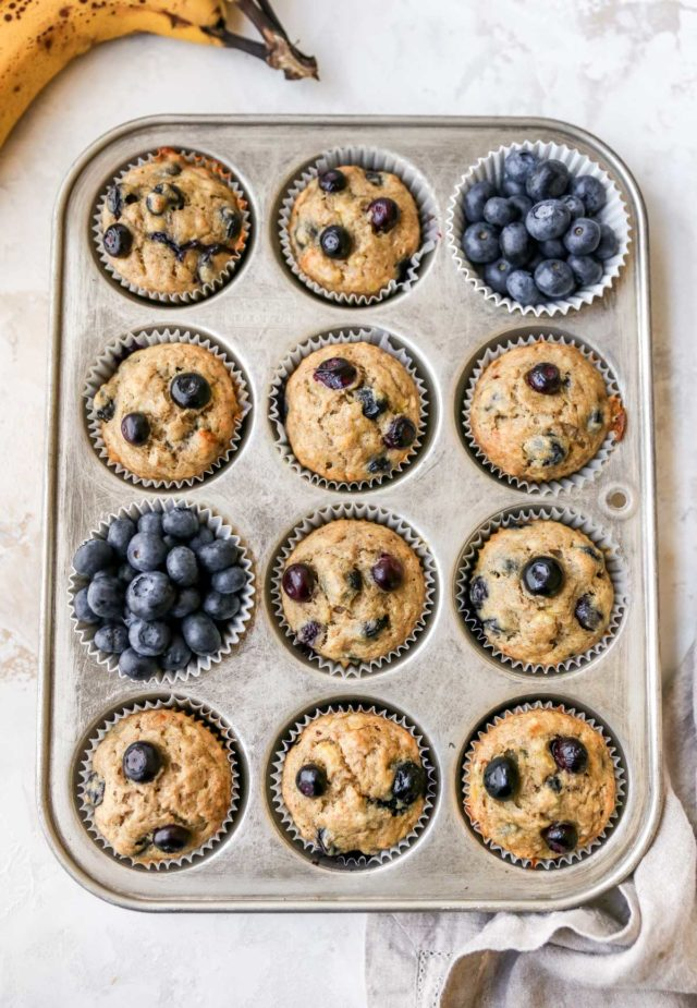 banana blueberry muffins in a muffin pan