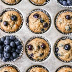 blueberry banana muffins in a baking pan