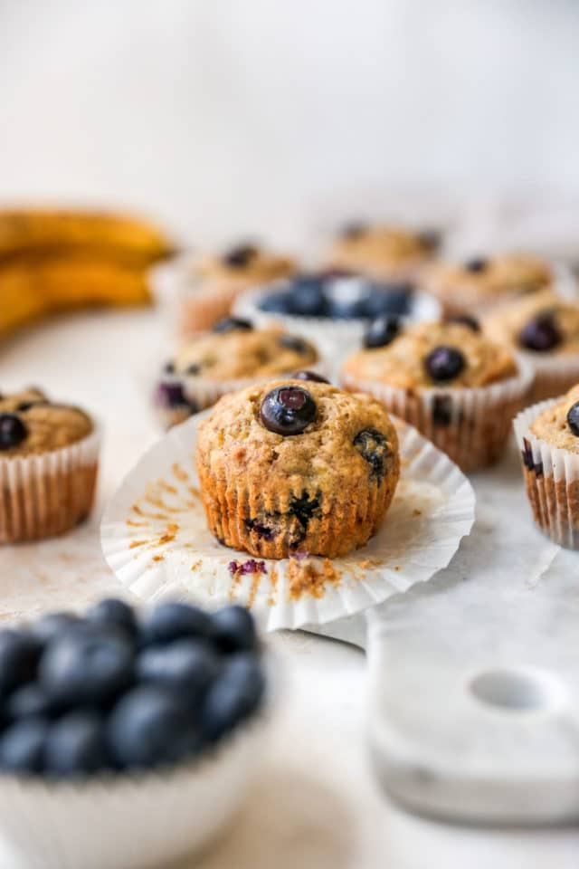 blueberry banana muffin taken out of a cupcake liner