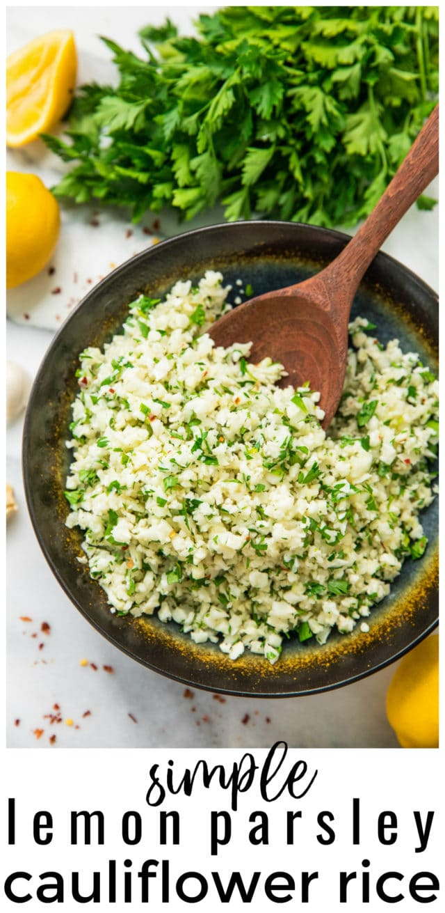 Simple Lemon Parsley Cauliflower Rice in a black bowl with wooden serving spoon