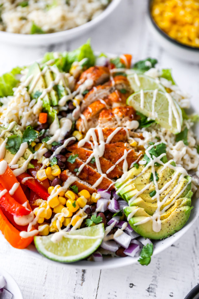 chicken burrito bowl with dressing drizzled over the top