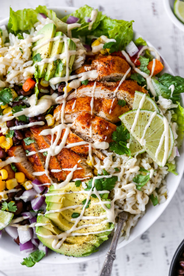 chicken burrito bowl with cilantro lime rice and lime wedges