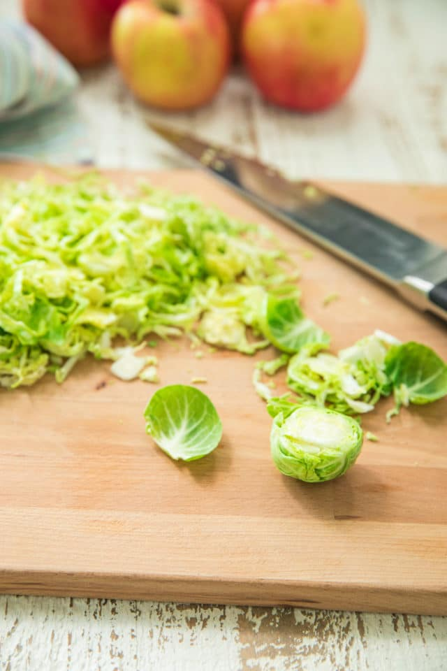 thinly slicing Brussels sprouts for the Autumn Shredded Brussels Sprouts Apple Salad
