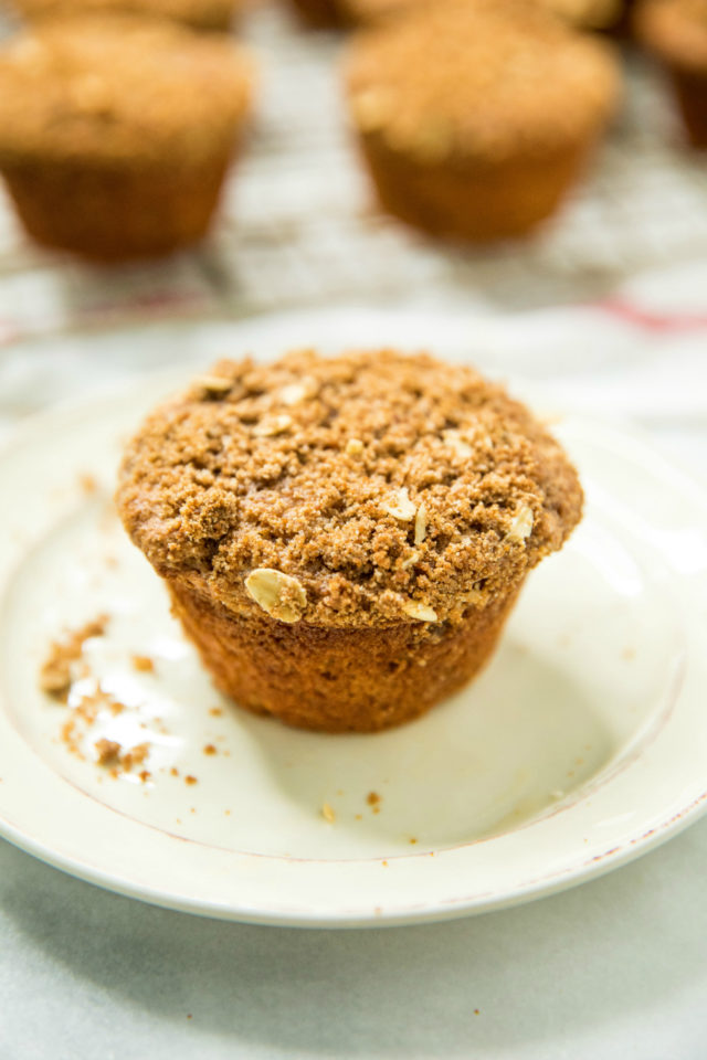 one of the Healthy Apple Spice Crumb Muffins sitting on a white plate