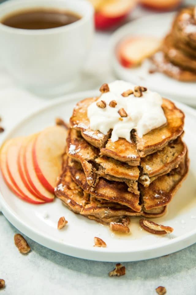 a stack of Apple Cinnamon Protein Pancakes on a white plate