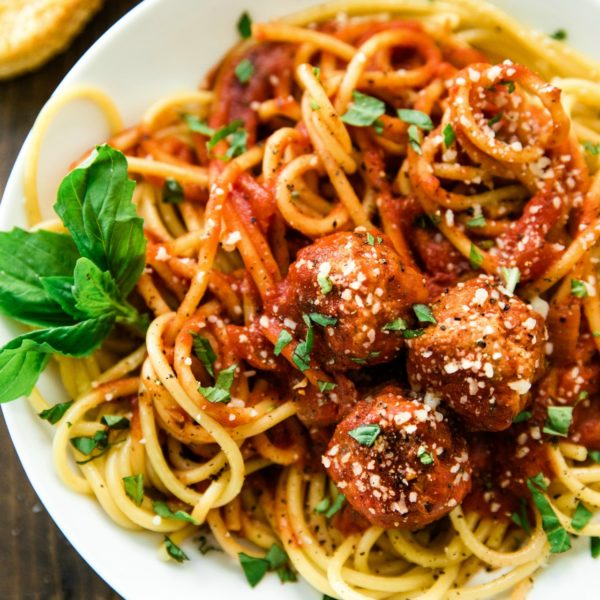 close up of the best EVER Spaghetti and Meatballs recipe on a white plate