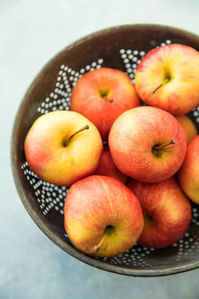 colander filled with honey crisp apples for Healthy Apple Crisp Stuffed Baked Apples