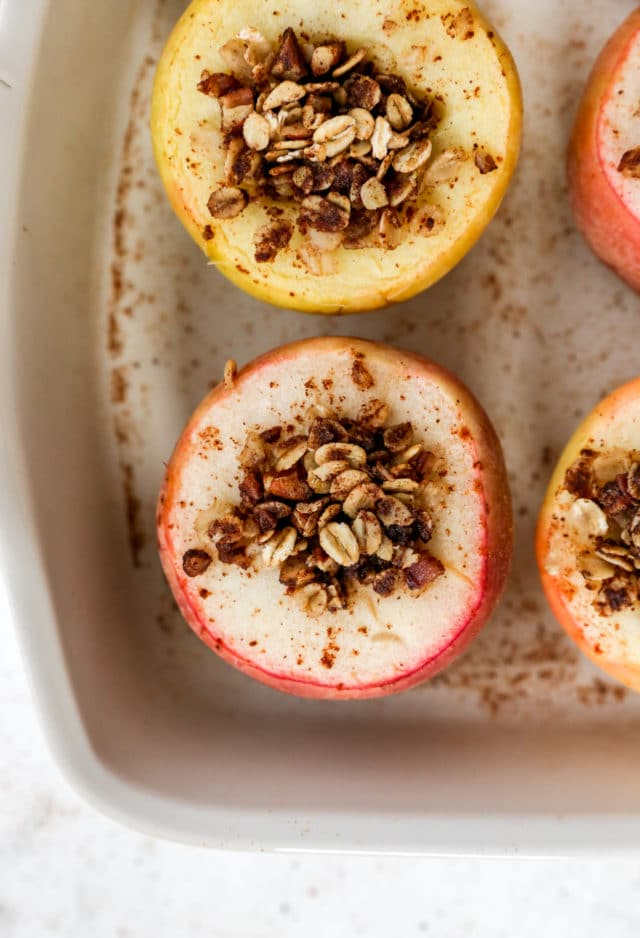 baked apples topped with cinnamon oats in a baking dish